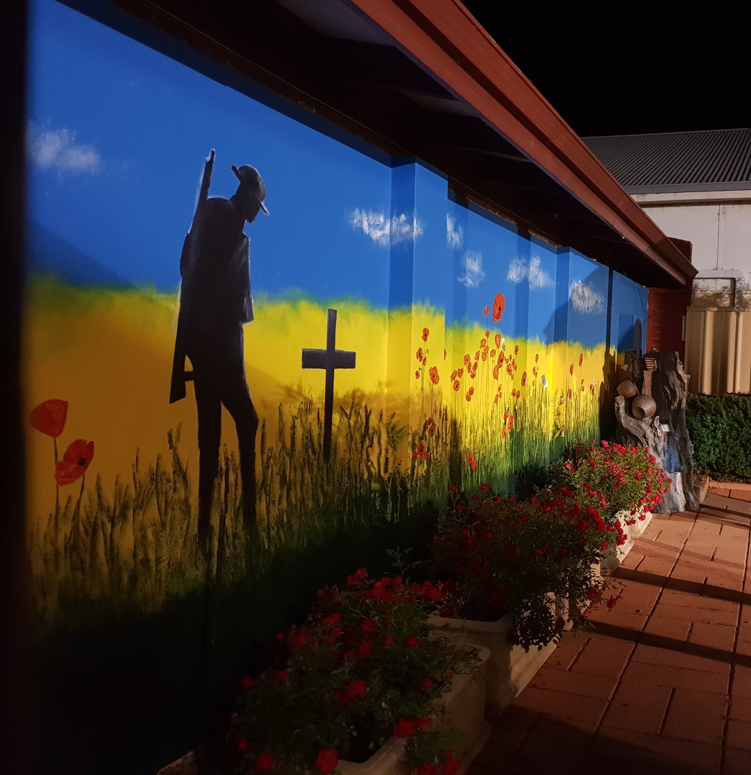 Mural at Northam RSL showing a lone digger in a field of poppies