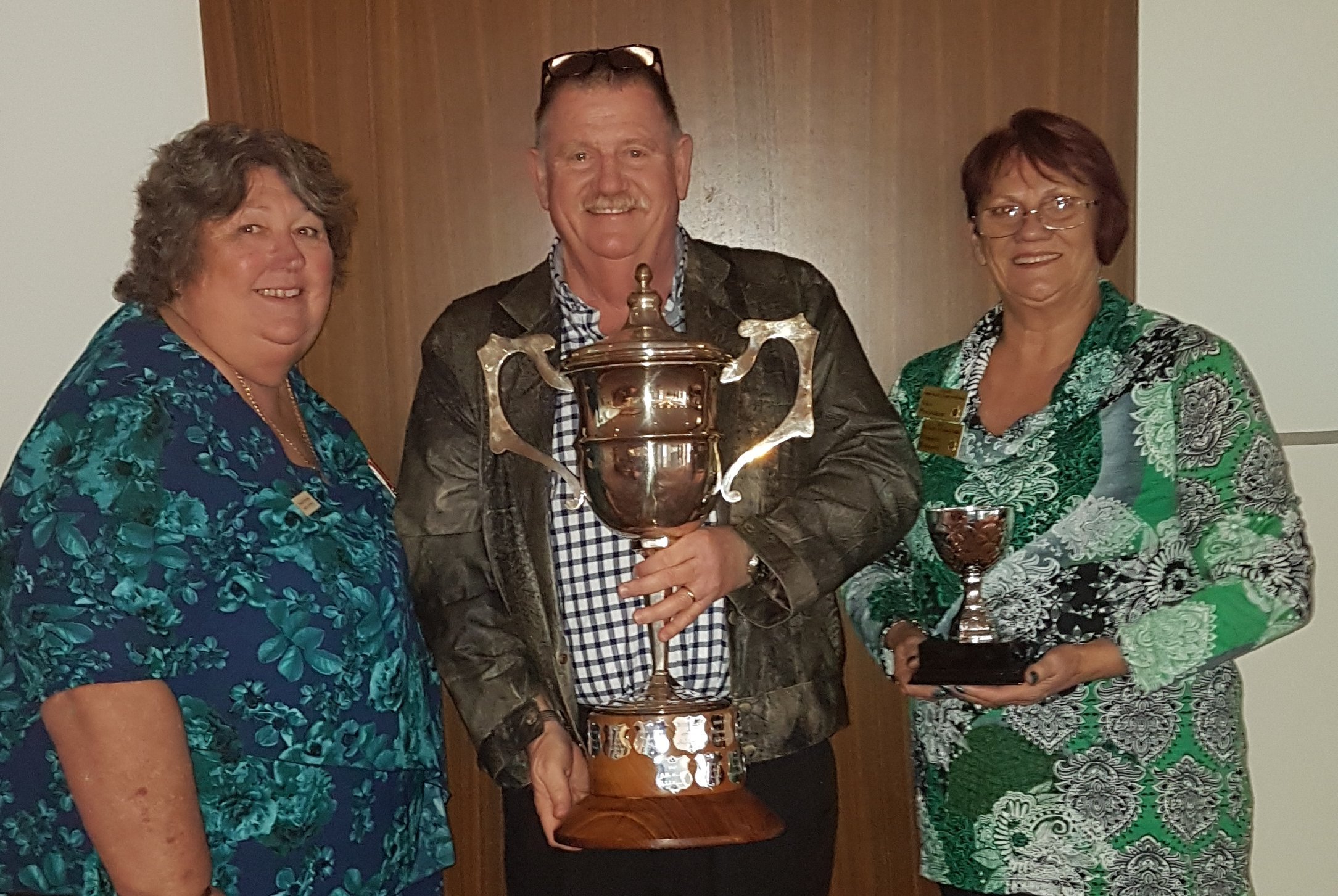 Donna Prytulak Northam RSL Membership officer and RSL WA Vice President, Mick Prytulak President Northam RSL and Denette Bernard Vice President Northam RSL  holding the Colonel Collett Trophy